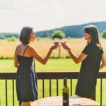 ladies drinking wine at Ft. Lewis Lodge & Farm