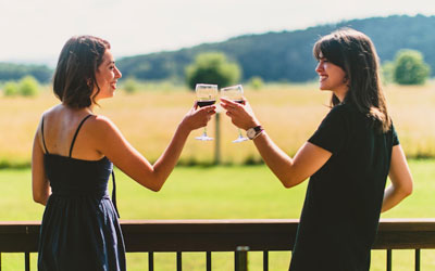 ladies drinking wine at Ft. Lewis Lodge & Farm